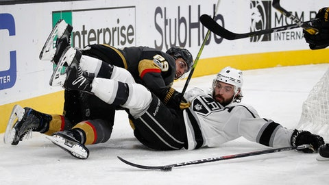 Los Angeles Kings defenseman Drew Doughty, right, and Vegas Golden Knights right wing Alex Tuch battle for the puck during the second period of an NHL hockey game, Sunday, Nov. 19, 2017, in Las Vegas. (AP Photo/John Locher)