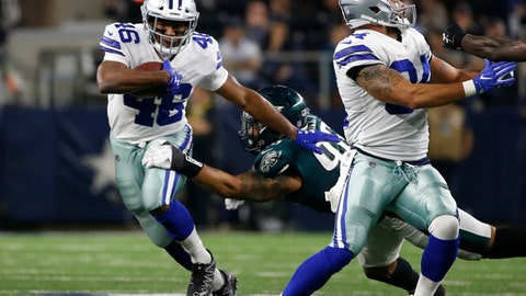 Dallas Cowboys running back Alfred Morris (46) attempts to escape pressure from the Philadelphia Eagles as Morris carries the ball in the first half of an NFL football game, Sunday, Nov. 19, 2017, in Arlington, Texas. (AP Photo/Ron Jenkins)