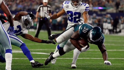 Philadelphia Eagles running back Corey Clement (30) leaps into the end zone after catching a pass for a two-point conversion after getting past Dallas Cowboys' Byron Jones, left, and Orlando Scandrick (32) in the second half of an NFL football game, Sunday, Nov. 19, 2017, in Arlington, Texas. (AP Photo/Ron Jenkins)
