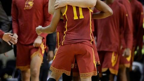 Southern California's Nick Rakocevic hugs guard Jordan McLaughlin (11) after Southern California beat Vanderbilt 93-89 in overtime in an NCAA college basketball game, Sunday, Nov. 19, 2017, in Nashville, Tenn. (AP Photo/Mark Humphrey)