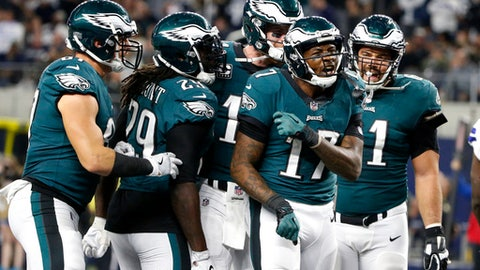 Philadelphia Eagles' Brent Celek, from left, LeGarrette Blount (29), Carson Wentz, rear, and Stefen Wisniewski, right, celebrate a touchdown catch made by Alshon Jeffery (17) in the second half of an NFL football game against the Dallas Cowboys on Sunday, Nov. 19, 2017, in Arlington, Texas. (AP Photo/Michael Ainsworth)
