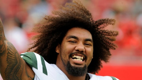 "FILE - This Nov. 12, 2017 file photo shows New York Jets defensive end Leonard Williams (92) before an NFL football game against the Tampa Bay Buccaneers in Tampa, Fla. The New York Jets were winners in the standings without even taking the field over the weekend. The coaches and players returned Monday, Nov. 20, 2017 from a bye-week break with the Jets sitting just one game out of a playoff spot, despite a 4-6 record and four losses in their last five games. ""We definitely still have high hopes,"" defensive end Leonard Williams said. ""And people are coming to practice with high energy and feel pretty positive about the rest of the season."" (AP Photo/Steve Nesius)"