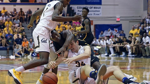 Wichita State forward Darral Willis Jr. (21) fights for a lose ball over California guard Darius McNeill (1) and forward Grant Anticevich (34) during the first half of an NCAA college basketball game, Monday, Nov. 20, 2017, in Lahaina, Hawaii. (AP Photo/Marco Garcia)