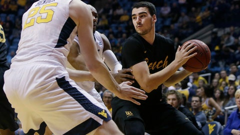 Long Beach State forward Gabe Levin (0) looks to make a pass while being trapped by West Virginia forward Maciej Bender (25) and guard Jevon Carter (2) during the first half of an NCAA college basketball game, Monday, Nov. 20, 2017, in Morgantown, W.Va. (AP Photo/Raymond Thompson)