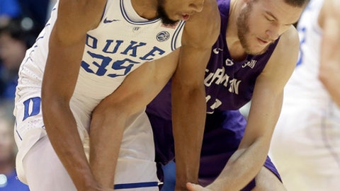Duke's Marvin Bagley III (35) and Furman's Matt Rafferty reach for the ball during the first half of an NCAA college basketball game in Durham, N.C., Monday, Nov. 20, 2017. (AP Photo/Gerry Broome)