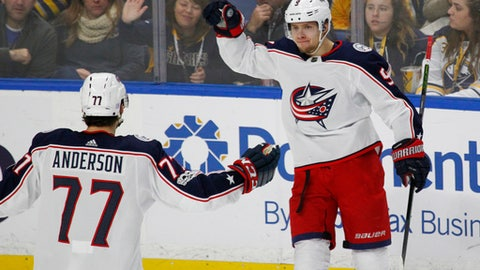 Columbus Blue Jackets Josh Anderson (77) and Artemi Panarin (9) celebrate a goal during the third period of an NHL hockey game against the Buffalo Sabres, Monday Nov. 20, 2017, in Buffalo, N.Y. (AP Photo/Jeffrey T. Barnes)