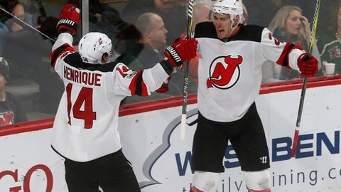 Jets score three goals in 95 seconds against Devils