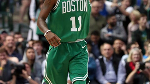 DALLAS, TX - NOVEMBER 20:  Kyrie Irving #11 of the Boston Celtics celebrates against the Dallas Mavericks at American Airlines Center on November 20, 2017 in Dallas, Texas. NOTE TO USER: User expressly acknowledges and agrees that, by downloading and or using this photograph, User is consenting to the terms and conditions of the Getty Images License Agreement.  (Photo by Tom Pennington/Getty Images)