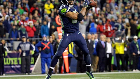 Seattle Seahawks' Doug Baldwin catches a touchdown pass in the end zone against the Atlanta Falcons late in the second half of an NFL football game, Monday, Nov. 20, 2017, in Seattle. (AP Photo/Ted S. Warren)