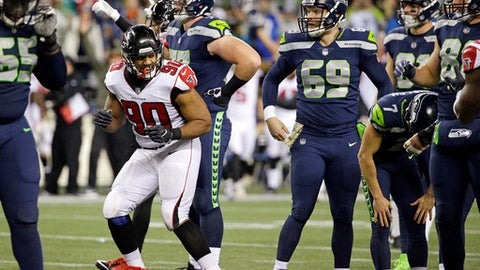 Seattle Seahawks kicker Blair Walsh (7) leans over with his hands on his knees as Atlanta Falcons' Derrick Shelby (90) happily reacts to Walsh's missed field goal attempt at the end of the second half of an NFL football game, Monday, Nov. 20, 2017, in Seattle. (AP Photo/Ted S. Warren)
