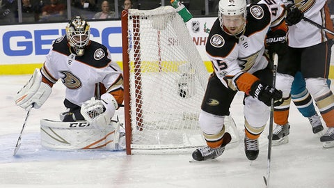 Anaheim Ducks defenseman Sami Vatanen (45), from Finland, skates in front of goalie Reto Berra (1), from Switzerland, during the second period of an NHL hockey game against the San Jose Sharks in San Jose, Calif., Monday, Nov. 20, 2017. (AP Photo/Jeff Chiu)