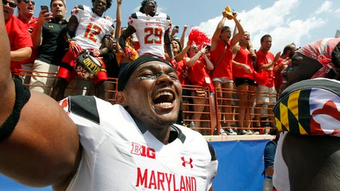 FILE - In this Sept. 2, 2017, file photo, Maryland's Jermaine Carter, Jr. front, celebrates with teammates and fans after defeating Texas in an NCAA college football game in Austin, Texas. Maryland senior linebacker Jermaine Carter Jr. on Saturday will wrap up an outstanding college career that featured impressive personal numbers but not enough wins to make it fully satisfying.  (AP Photo/Michael Thomas, File)