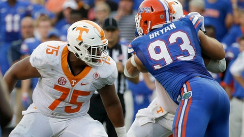 FILE - In this Sept. 26, 2015, file photo, Tennessee offensive lineman Jashon Robertson (75) plays against Florida defensive lineman Taven Bryan (93) in an NCAA college football game, in Gainesville, Fla. Robertson was one of the Tennessee seniors who arrived on campus three years ago amid expectations that they would lead the program back to Southeastern Conference title contention. It didn't quite work out that way. Only a fraction of that class remains as those seniors prepare to close their careers, and the coach who recruited them has been fired. (AP Photo/John Raoux, File)