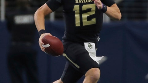 FILE - In this Nov. 11, 2017, file photo, Baylor quarterback Charlie Brewer runs against Texas Tech in the first half of an NCAA college football game, in Arlington, Texas. Shawn Robinson and Charlie Brewer played in the same NFL stadium on the same day just more than 11 months ago. They were in different championship games. The two Texas Class 6A high school state champion quarterbacks are now Big 12 freshmen, and going against each other in a regular-season finale. Brewer will start for Baylor, and Robinson is coming off his first start for No. 10 TCU. (Jerry Larson/Waco Tribune Herald, via AP, File)