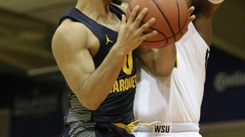 Marquette guard Markus Howard (0) goes to the net while being guarded by Wichita State center Shaquille Morris (24) during the first half of an NCAA college basketball game, Tuesday, Nov. 21, 2017, in Lahaina, Hawaii. (AP Photo/Marco Garcia)