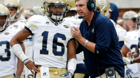 FILE - In this Saturday, Nov. 11, 2017, file photo, Georgia Tech head coach Paul Johnson, right, talks with quarterback TaQuon Marshall during the third quarter of an NCAA college football game against Virginia Tech in Atlanta. Georgia Tech's last hope of putting a positive cap on a disappointing 2017 season comes in Saturday's state rivalry game against No. 7 Georgia. The good news for the Yellow Jackets is the game will be played on their home field, where they are 5-0 this season. (AP Photo/David Goldman, File)