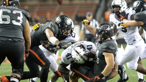 FILE- This Sept. 9, 2017, file photo shows Oregon State running back Ryan Nall, right, fumbling the ball after taking a hit from Minnesota's Thomas Barber in the second half of an NCAA college football game, in Corvallis, Ore. Near the end of a rough season for Minnesota, there's a strength for the future in a core of sophomore defensive players who are all natives of the state and already playing key roles. Barber, Carter Coughlin and Kamal Martin are also the best of friends.  (AP Photo/Timothy J. Gonzalez, File)