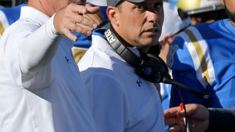 This photo taken Oct. 21, 2017, shows UCLA head coach Jim Mora, left, gesturing as he stands with offensive coordinator Jedd Fisch during the second half of an NCAA college football game against Oregon, in Pasadena, Calif.  Fisch is UCLA's head coach for the week after Jim Mora's surprise firing, and he's hoping to extend that gig for at least another month. The veteran offensive coordinator has been promoted for the Bruins' season finale against California, and Fisch hopes to honor Mora's legacy with a win that would make UCLA bowl-eligible. (AP Photo/Mark J. Terrill)