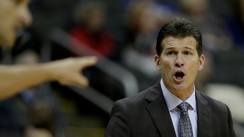 UCLA head coach Steve Alford talks to an official during the first half of an NCAA college basketball game against Wisconsin in the Hall of Fame Classic, Tuesday, Nov. 21, 2017, in Kansas City, Mo. (AP Photo/Charlie Riedel)