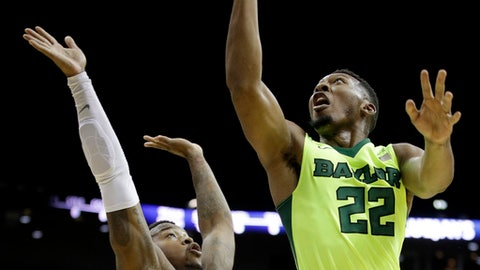 Baylor's King McClure (22) shoots over Creighton's Marcus Foster during the first half of an NCAA college basketball game in the Hall of Fame Classic, Tuesday, Nov. 21, 2017, in Kansas City, Mo. (AP Photo/Charlie Riedel)