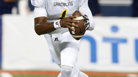 FILE-This Sep. 10, 2016, file photo shows Grambling State quarterback DeVante Kincade (1) during the first half of an NCAA college football game against Arizona, in Tucson, Ariz.  The grind of playing football at a Historically Black College or University has been well documented. Practicing in gyms, little television money and long bus trips are just part of the deal. But playing at an HBCU is not what players don't have or entertaining halftime shows, it's about community. Kincade said it is an experience to savor. (AP Photo/Rick Scuteri, File)