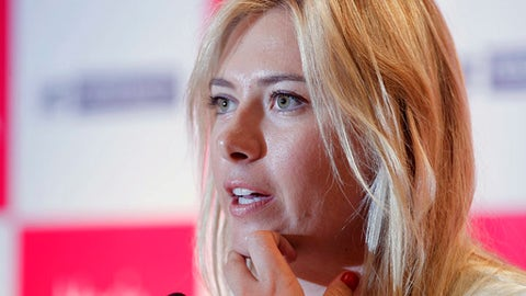 FILE- In this Nov. 11, 2012 file photo, Russian tennis player Maria Sharapova addresses a press conference to endorse Infrastructure development company Homestead in New Delhi, India. Sharapova is being investigated by police in India in a cheating and criminal conspiracy case involving the real estate company who used the tennis star to endorse a luxury housing project that never took off. (AP Photo/Mustafa Quraishi, File)
