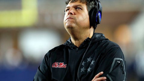 FILE - In this Nov. 18, 2017, file photo,Mississippi interim coach Matt Luke looks at the replay of a play on the video board in the final minutes of an NCAA college football game against Texas A&M in Oxford, Miss. No. 16 Mississippi State is heavily favored heading into Thursday's Egg Bowl, but coach Dan Mullen won't take struggling Ole Miss lightly.  (AP Photo/Rogelio V. Solis, File)