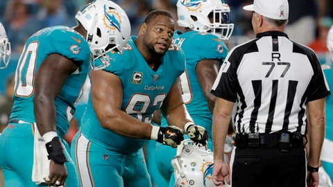 FILE - In this Nov. 5, 2017, file photo, Miami Dolphins defensive tackle Ndamukong Suh (93) gestures to referee Terry McAuley (77) during the first half of an NFL football game against the Oakland Raiders in Miami Gardens, Fla. The Dolphins rank second in the NFL in penalties and the problem seems to be getting worse, which doesn't help their chances Sunday at New England. (AP Photo/Lynne Sladky, File)