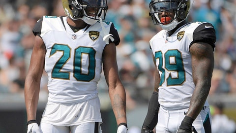 """FILE - In this Sept. 17, 2017, file photo, Jacksonville Jaguars cornerback Jalen Ramsey (20) and free safety Tashaun Gipson (39) wait for a play during the second half an NFL football game against the Tennessee Titans in Jacksonville, Fla. Gipson and his fellow defensive backs have started a """"DB fund"""" that grows every time one of them drops an interception. The secondary plans to use the money for a group trip after the season. (AP Photo/Phelan M. Ebenhack, File)"""