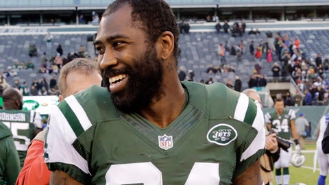 FILE - In this Jan. 1, 2017, file photo, New York Jets cornerback Darrelle Revis walks on the field after an NFL football game in East Rutherford, N.J. A judge on Wednesday, March 15, 2017, has dismissed all charges against former New York Jets cornerback Darrelle Revis stemming from a fight last month in Pittsburgh. Revis had been charged with aggravated assault and other counts from a fight Feb. 12 in which two men were punched and knocked out. (AP Photo/Seth Wenig, File)