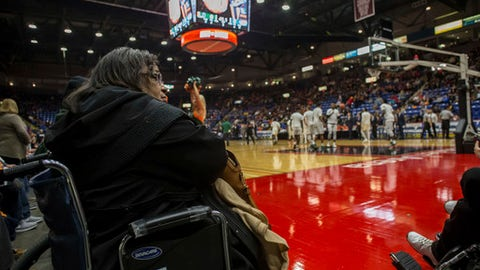 "Eleanor ""Mama El"" Carter, grandmother of Miami's Lonnie Walker IV, watches from court side as her grandson's team warms up prior to the first half of an NCAA college basketball game against La Salle, Wednesday, Nov. 22, 2017, in Reading, Pa. (AP Photo/Chris Szagola)"