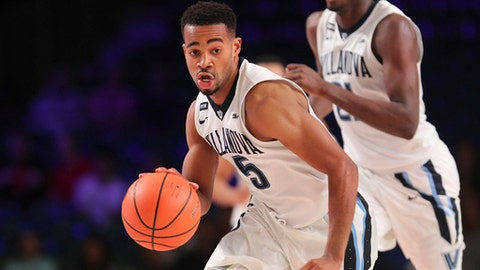 Villanova guard Phil Booth (5) brings the ball up during an NCAA college basketball game against Western Kentucky on Wednesday, Nov. 22, 2017, in the Battle 4 Atlantis tournament in Paradise Island, Bahamas. (Tim Aylen/Bahamas Visual Services Photo via AP)