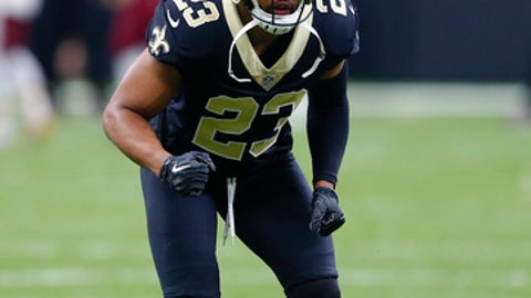 FILE - In this Nov. 19, 2017, file photo .New Orleans Saints cornerback Marshon Lattimore (23) warms up for the team's NFL football game against the Washington Redskins in New Orleans. Lattimore did not practice Wednesday, Nov. 22, because of a left ankle injury which occurred in last Sunday's victory. A first-round draft choice and the Saints' top cornerback this season, Lattimore limped through the locker room wearing a protective boot on his lower left leg while it was open to reporters. (AP Photo/Butch Dill, File)