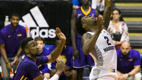 LSU forward Aaron Epps (21) fowls Marquette guard Sacar Anim (2) as he goes for net during the first half of an NCAA college basketball game, Wednesday, Nov. 22, 2017, in Lahaina, Hawaii. (AP Photo/Marco Garcia)
