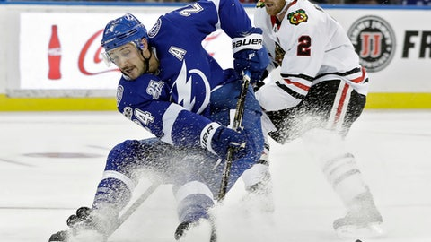 Tampa Bay Lightning right wing Ryan Callahan (24) stops short after getting around Chicago Blackhawks defenseman Duncan Keith (2) on a breakaway during the second period of an NHL hockey game Wednesday, Nov. 22, 2017, in Tampa, Fla. (AP Photo/Chris O'Meara)
