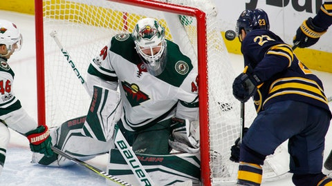Buffalo Sabres forward Sam Reinhart (23) is stopped by Minnesota Wild goalie Devan Dubnyk (40) during the third period of an NHL hockey game, Wednesday Nov. 22, 2017, in Buffalo, N.Y. (AP Photo/Jeffrey T. Barnes)