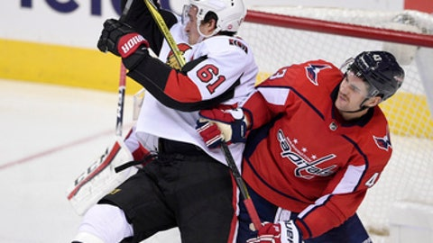 Washington Capitals right wing Tom Wilson (43) tangles with Ottawa Senators right wing Mark Stone (61) during the third period of an NHL hockey game, Wednesday, Nov. 22, 2017, in Washington. The Capitals won 5-2. (AP Photo/Nick Wass)