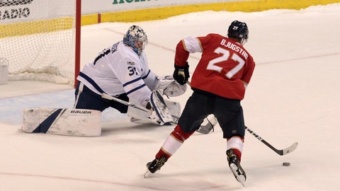 Florida Panthers' Nick Bjugstad (27) scores the winning goal against Toronto Maple Leafs goalie Frederik Andersen (31), of Denmark, during a shootout of an NHL hockey game, Wednesday, Nov. 22, 2017, in Sunrise, Fla. The Panthers won 2-1 in a shootout. (AP Photo/Luis M. Alvarez)