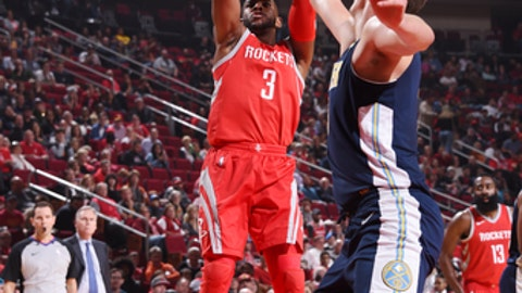 HOUSTON, TX - NOVEMBER 22:  Chris Paul #3 of the Houston Rockets shoots the ballagainst the Denver Nuggets on November 22, 2017 at the Toyota Center in Houston, Texas. NOTE TO USER: User expressly acknowledges and agrees that, by downloading and or using this photograph, User is consenting to the terms and conditions of the Getty Images License Agreement. Mandatory Copyright Notice: Copyright 2017 NBAE (Photo by Bill Baptist/NBAE via Getty Images)