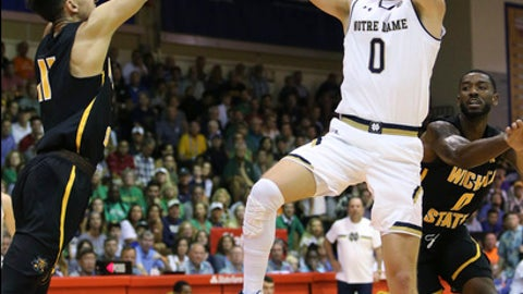 Notre Dame guard Rex Pflueger (0) shoots over Wichita State guard Landry Shamet (11) during the first half of an NCAA college basketball game, Wednesday, Nov. 22, 2017, in Lahaina, Hawaii. (AP Photo/Marco Garcia)