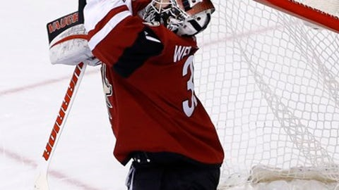 Arizona Coyotes goalie Scott Wedgewood makes a save on a shot by the San Jose Sharks during the second period of an NHL hockey game Wednesday, Nov. 22, 2017, in Glendale, Ariz. (AP Photo/Ross D. Franklin)