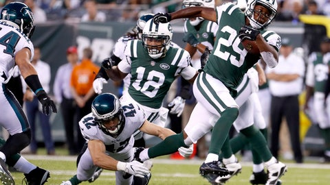 FILE - In this Aug. 31, 2017, file photo, New York Jets running back Bilal Powell (29) avoids a tackle by Philadelphia Eagles free safety Chris Maragos (42) during the first half of an NFL football game in East Rutherford, N.J. Maragos and his wife welcomed their third child, daughter Cambria Rose, on October 16. He had his torn posterior cruciate ligament repaired a few weeks later. The injury is expected to keep him off the field until training camp. So while the Eagles (9-1) continue their pursuit of the franchise's first Super Bowl title, Maragos is forced to watch from the sideline. (AP Photo/Michael Noble Jr., File)
