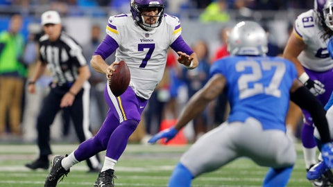 Minnesota Vikings quarterback Case Keenum (7) scrambles during the first half of an NFL football game against the Detroit Lions, Thursday, Nov. 23, 2017, in Detroit. (AP Photo/Paul Sancya)