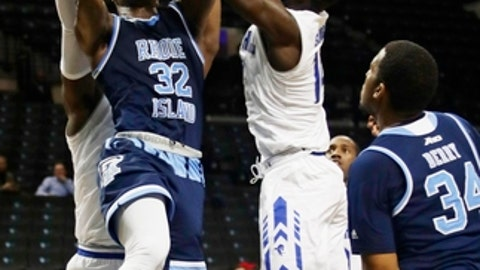 Rhode Island's Jared Terrell (32) shoots over Seton Hall's Ismael Sanogo (14) during the second half of an NCAA college basketball game in the NIT Season Tip-Off tournament Thursday, Nov. 23, 2017, in New York. Rhode Island won 75-74. (AP Photo/Frank Franklin II)