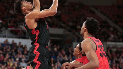 Gonzaga's Johnathan Williams (3) scores as Ohio State's Keita Bates-Diop (33) watches during the first half of an NCAA college basketball game during the Phil Knight Invitational tournament in Portland, Ore., Thursday, Nov. 23, 2017. (AP Photo/Timothy J. Gonzalez)