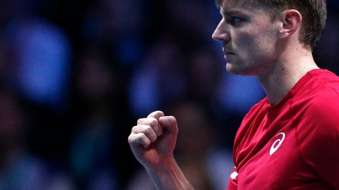 Belgium's David Goffin clenches his fist after winning a point as he plays France's Lucas Pouille during their Davis Cup final single match at the Pierre Mauroy stadium in Lille, northern France, Friday, Nov. 24, 2017. (AP Photo/Michel Spingler)