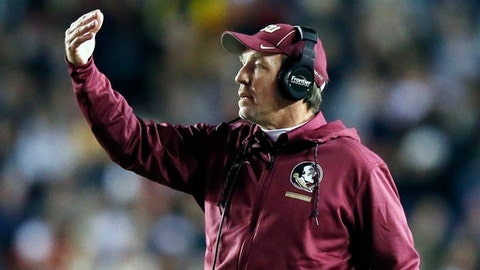 FILE - In this Oct. 27, 2017, file photo, Florida State head coach Jimbo Fisher directs his team during the first half of an NCAA college football game against Boston College in Boston.  In-state rivals Florida State and Florida have rarely experienced losing like this, the Seminoles need a victory to keep alive hopes of making a bowl game for the 36th consecutive year. The Gators are trying to send their seniors and interim coach Randy Shannon out on a high note to end one of the program's worst seasons in decades.  (AP Photo/Michael Dwyer, File)
