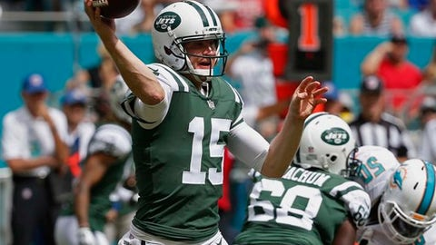 In this Sunday, Oct. 22, 2017 file photo, New York Jets quarterback Josh McCown (15) looks to pass during the first half of an NFL football game against the Miami Dolphins in Miami Gardens, Fla. The Carolina Panthers are roaring into their favorite part of the season.  It's the home stretch with six games, and at 7-3 with a three-game winning streak, it's no surprise the Panthers are starting to heat up. The Carolina Panthers play the Jets on Sunday, Nov. 26, 2017.  Both the Panthers and Jets are coming off bye-week breaks, so they're well-rested. (AP Photo/Wilfredo Lee, File)
