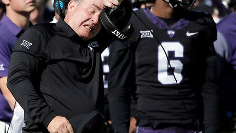 TCU head coach Gary Patterson wipes his brow during the first half of an NCAA college football game against Baylor, Friday, Nov. 24, 2017, in Fort Worth, Texas. (AP Photo/Brandon Wade)