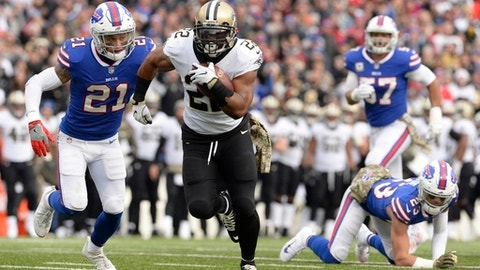 FILE - In this Nov. 12, 2017, file photo, New Orleans Saints' Mark Ingram (22) rushes past Buffalo Bills' Jordan Poyer (21) and Micah Hyde (23) during the first half of an NFL football game in Orchard Park, N.Y. A few weeks ago, New Orleans' first visit to LA since the 1990s seemed highly unlikely to be a meeting of division leaders. But with standout seasons from running backs Ingram and Todd Gurley, the Rams (7-3) and the Saints (8-2) are two of the NFL's most pleasant surprises. (AP Photo/Adrian Kraus, File)